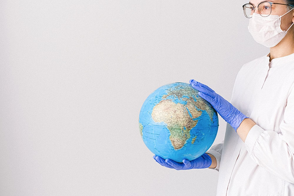 Civilization diseases: The doctor is holding a globe